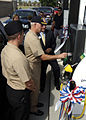 US Navy 100730-N-6676S-031 Capt. K.J. Johnson, commanding officer of Naval Station Norfolk, swipes his credit card to pay for E85 fuel in the first vehicle to use the newest flex-fuel pump built in the Hampton Roads area.jpg