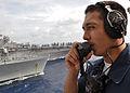 US Navy 101018-N-3620B-055 Yeoman Seaman Jarret Gutierrez stands the bridge-to-bridge phone talker watch aboard the amphibious transport dock ship.jpg