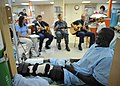 US Navy 110610-N-NY820-215 U.S. Fleet Forces Band members and Latter Day Saints Charities volunteers play music for Patients aboard the Military Se.jpg