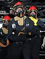 US Navy 110627-N-QL471-178 Sailors man a fire hose during a general quarters training exercise in the pilothouse aboard the aircraft carrier USS Ge.jpg