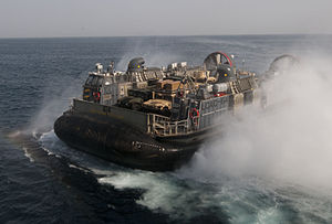 US Navy 120106-N-PB383-070 A landing craft air cushion (LCAC) assigned to Assault Craft Unit (ACU) 5 departs the well deck of the amphibious transp.jpg
