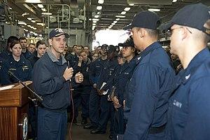 US Navy 120127-N-KS651-081 Cmdr. Homer Denius, commanding officer of the amphibious dock landing ship USS Pearl Harbor (LSD 52), addresses Sailors.jpg