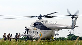 Ukrainian Naval Infantry -  Ukraine marines and naval corpsmen simulating casualty extraction using a Mi-8 during the multinational Sea Breeze exercise in 2011.