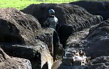 ukrainian soldier in the trenches during the war in donbass