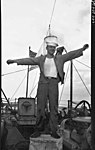 Unidentified US naval crewman of the USS MILWAUKEE (III) (3294312212).jpg