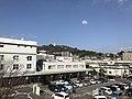 View of Mount Hanaokayama from pedestrian deck in front of Kumamoto Station.jpg