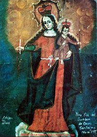 una fotografía de la Virgen del socavon en Bolivia.