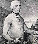 Black-and-white print shows a clean-shaven white-haired man in a white military uniform. He is shown standing from head to waist.