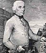 Black and white print shows a clean-shaven white-haired man in a white military uniform. He is shown standing from head to waist.