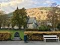 Voss Church (Voss kirke-kyrkje, Vangskyrkja), Voss, Norway 2016-10-25 -09- southern wall, park, Heiagjengen sculpture by Solveyg W. Schafferer, bench.jpg