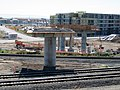 Warm Springs pedestrian bridge and TOD construction (1), June 2019.JPG