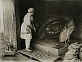 With the British Navy in wartime - Working a machine to extract the metal from the rubbish (15217414125).jpg