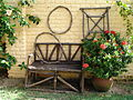 Wooden garden bench and trellises.jpg