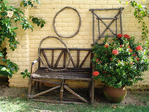 Wooden garden bench and trellises