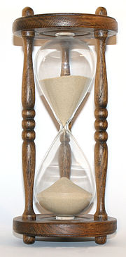 The flow of sand in an hourglass can be used to keep track of elapsed time. It also concretely represents the present as being between the past and the future.