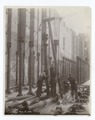 Workers erecting metal columns and a pulley (NYPL b11524053-489501).tiff