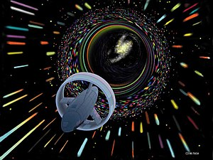 "Interstellar travel - Artist's depiction of a hypothetical Wormhole Induction Propelled Spacecraft, based loosely on the 1994 ""warp drive"" paper of Miguel Alcubierre. Credit: NASA CD-98-76634 by Les Bossinas."
