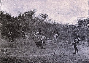 Nueva Ecija - Wounded American on stretcher in the Philippines, 1899