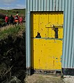 Yellow door at Dunseverick harbour - geograph.org.uk - 1256056.jpg