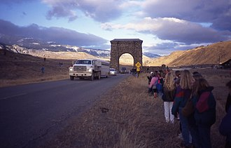 Wolf reintroduction - People look on as the grey wolves are trucked through Roosevelt Arch, Yellowstone National Park, January 1995.