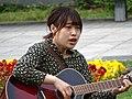Young Woman Playing Guitar - Odorikoen - Sapporo - Hokkaido - Japan (47971095161).jpg