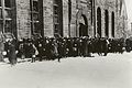 """""""People waiting for food supplies at Armouries"""" (15750612920).jpg"""
