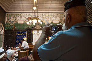 Syrian Jews - Syrian Jews worship in Ades Synagogue.  Renowned as a center for Syrian Hazzanut (Syrian Jewish liturgical singing), Ades is one of only two synagogues in the world that maintains the ancient Syrian Jewish tradition of Baqashot, the marathon Kabbalistic singing held in the early hours of Shabbat morning to welcome the sunrise over winter months.