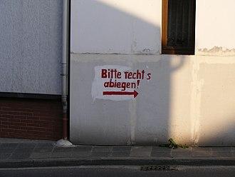 Kirchheim an der Weinstraße - Detour sign at a house damaged in an accident