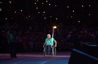 Australia at the 1972 Summer Paralympics - Wheelchair basketball captain and coach at the Opening Ceremony of the Sydney Paralympics in 2000.