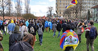 Xinjiang conflict - Protesters in Prague, Czech Republic carrying Tibetan and East Turkestan flags, 29 March 2016