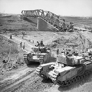 21st Army Tank Brigade - Churchill tanks of 21st Army Tank Brigade cross the River Reno close to a destroyed railway bridge, Italy, 18 April 1945
