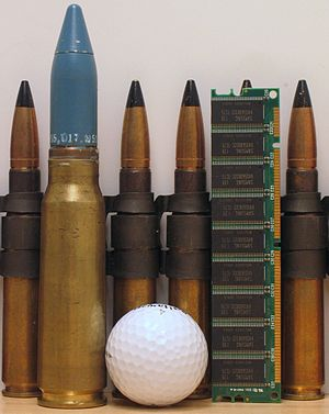 20 mm caliber - 20×102mm round with .50 BMG rounds, golf ball, stick of SDRAM computer memory.