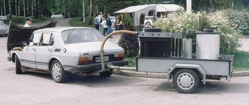 Saab 99 running on wood gas. Gas generator on trailer.