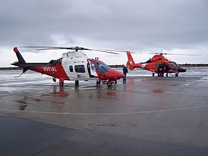 Air ambulances in the United States - An Airlift Northwest Crew receives a patient transfer from the United States Coast Guard