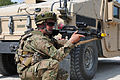 A Georgian soldier with Delta Company, 32nd Infantry Battalion aims his M4 carbine during a mission rehearsal exercise at the Joint Multinational Readiness Center in Hohenfels, Germany, Aug. 5, 2012 120805-A-UZ726-003.jpg