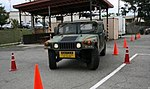 A U.S. Soldier navigates his Humvee around cones during driver training day at Camp Walker, Republic of Korea, Sept 110906-A-HW223-123.jpg