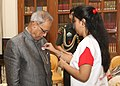 A member of the Indian Red Cross Society (National Capital Territory Branch) pinning a flag to the President, Shri Pranab Mukherjee, on the occasion of Red Cross Flag Week, at Rashtrapati Bhavan, in New Delhi.jpg