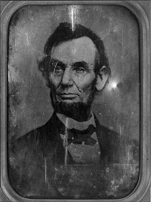 United States five-dollar bill - Daguerreotype of Lincoln taken on the same February day by Mathew Brady, used for the redesigned $5 bills from 1999 onwards. Note that this image is a mirror of Lincoln as he appears on the bill - this is because the daguerreotype process produced a single positive image (rather than a negative made on film, which is then used to make a true photographic positive), and the daguerreotype was always a mirror image of the subject material. Thus, the way Lincoln appears on the bill is actually how he appeared when seated for the picture.