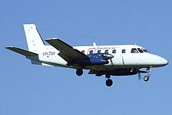 Aeropelican (VH-TLH) Embraer EMB 110P1 Bandierante on final approach at Sydney Airport.jpg
