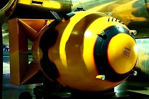 Fat Man - Replica mockup displayed in the Wright-Patterson Air Force Museum, beside the Bockscar B-29 that dropped the original device – black liquid asphalt sealant was sprayed over the original bomb casing's seams, simulated on the mockup.