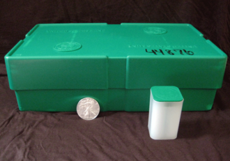 "American Silver Eagle - A green plastic box used by the United States Mint for shipping American Silver Eagle bullion coins. Each ""monster box"" holds 25 smaller plastic tubes (shown) which hold 20 coins each for a total of 500 coins."