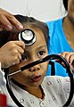 An Indonesian girl plays with a stethoscope during a surgical civic action project aboard hospital ship USNS Mercy (T-AH 19) in North Sulawesi, Indonesia, June 6, 2012, during Pacific Partnership 2012 120606-O-ZZ999-008.jpg