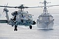 An SH-60R Sea Hawk helicopter flies ahead of USS Chung Hoon. (20532987702).jpg