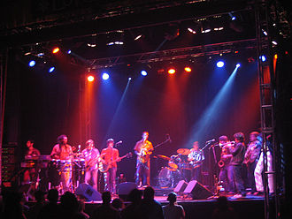 Love This Giant - Antibalas Afrobeat Orchestra is one of several guests on the album, augmenting the songs with their horn sections.