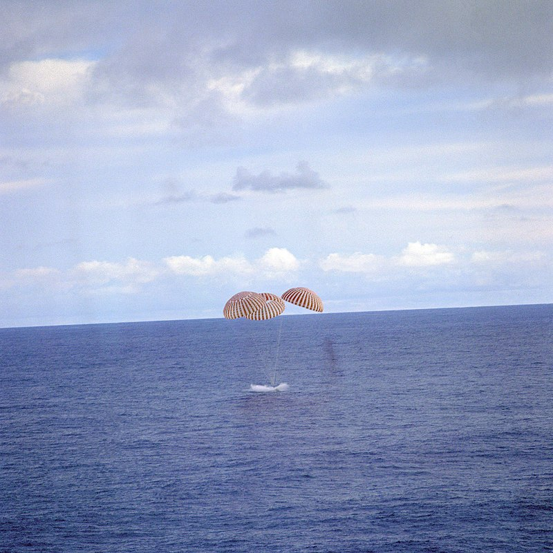 Spaceship contacts ocean under parachute