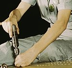 Arm detail, Drilling on a Liberator Bomber, Consolidated Aircraft Corp.1a34963v (cropped).jpg