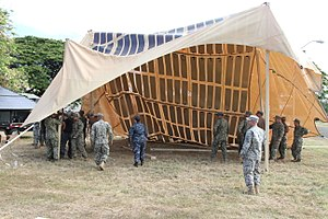 Climate security - Setup of a solar shade canopy for humanitarian aid and disaster relief. The solar shade has the potential to provide enough energy for continuous 24-hour use.