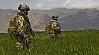 us army special forces soldiers from the 3rd special forces group patrol a field in the gulistan district of farah afghanistan