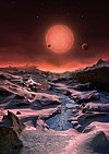 Artist's impression of the ultracool dwarf star TRAPPIST-1 from the surface of one of its planets.jpg