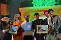 Ashwini Brahma and Navpreet Arora being felicitated during 22nd Odisha State Film Award 01.JPG